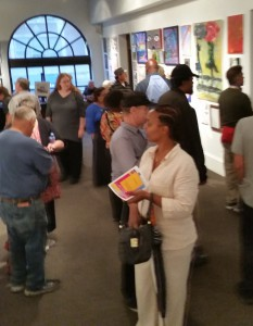 The crowd in the gallery space at the Visions exhibitions