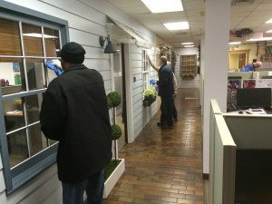 Workers cleaning windows at CHOICE as part of the jobs training program