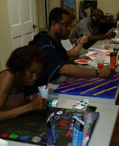 Several of the CHOICE Art Group members hard at work on pieces for ArtsFest in New Rochelle