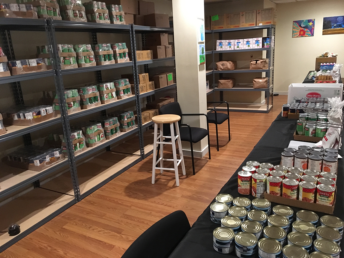 The CHOICE food pantry with shelves full of canned goods