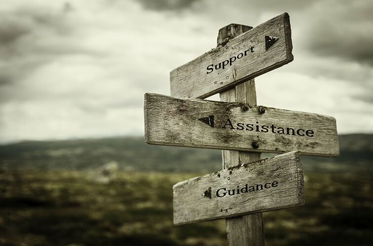 sign post with signs pointing to support, assistance, and guidance
